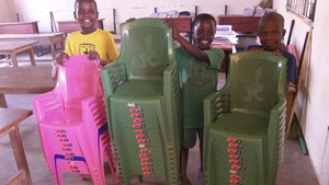 Children Show off Some of the New Chairs