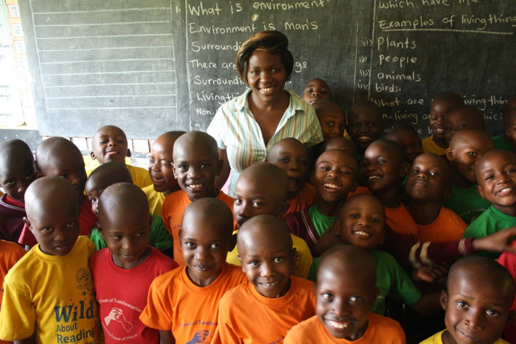 Teacher Caroline and some of her P2 students