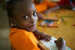 a second grader enjoying an art activity