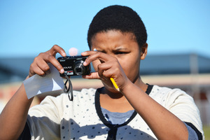 Youth taking photographs for media projects