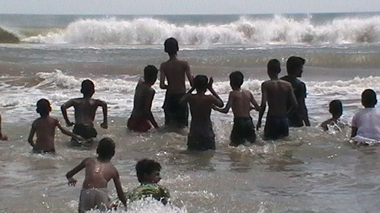 Boys catching waves!