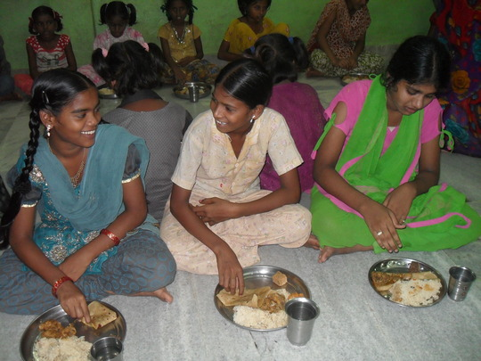 More girls enjoying their dinner.