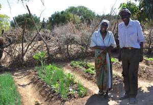 Mr. and Mrs. Dube with their garden