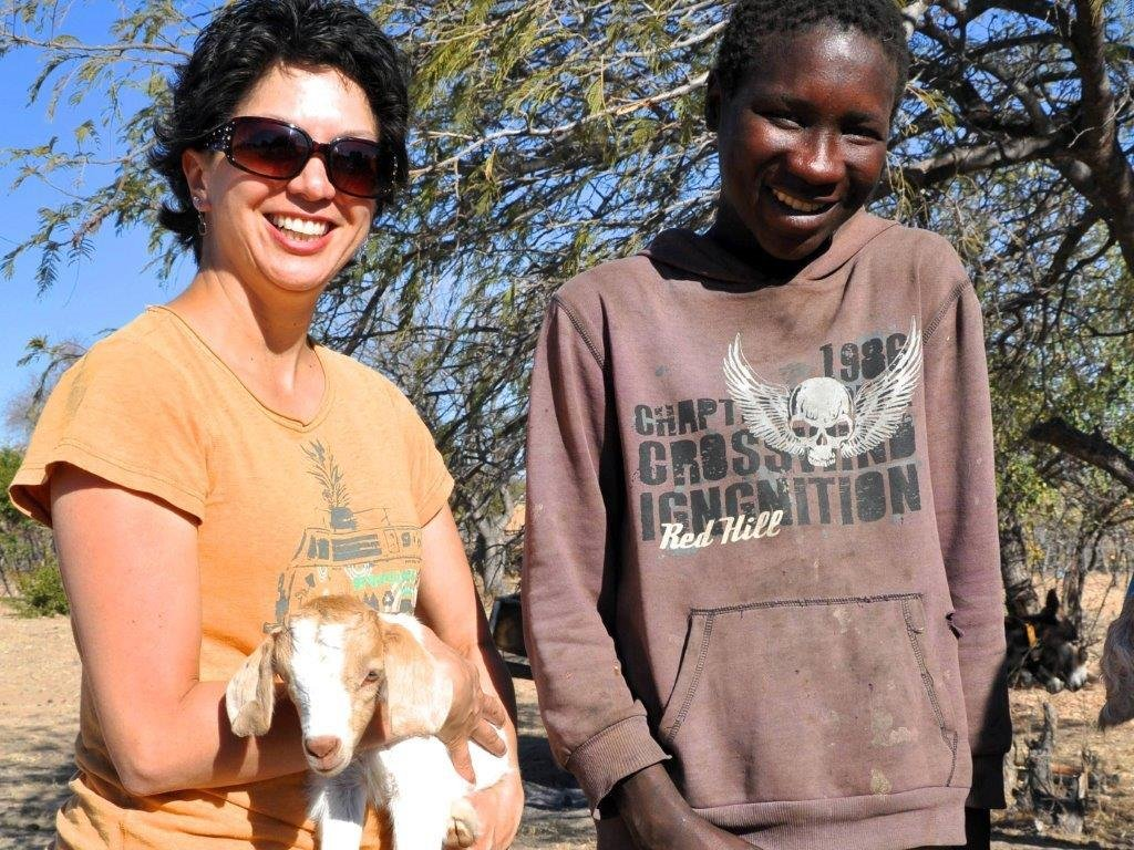 Goats recipient with new kid - his herd grows!