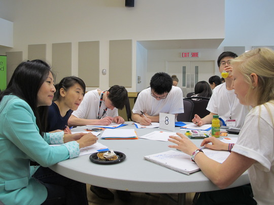 Group of OSC students work together with a mentor.