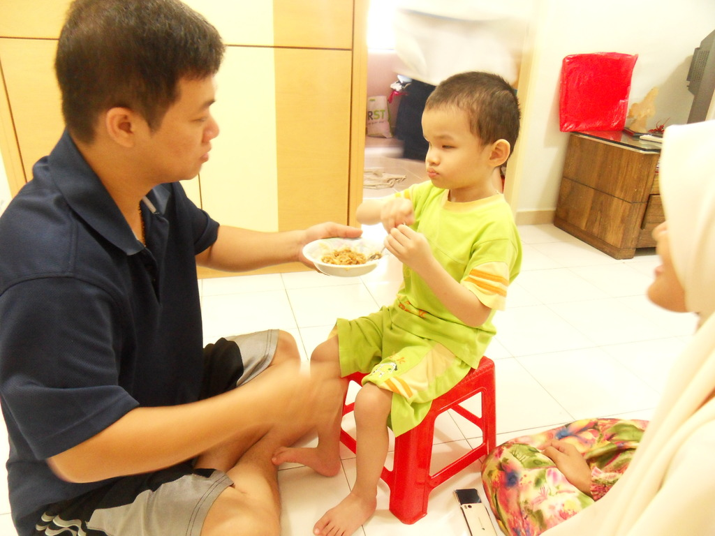 Yeap learning to eat on his own
