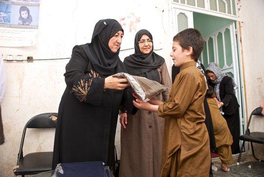 Children Receiving Clothing  Credit: A. Everett