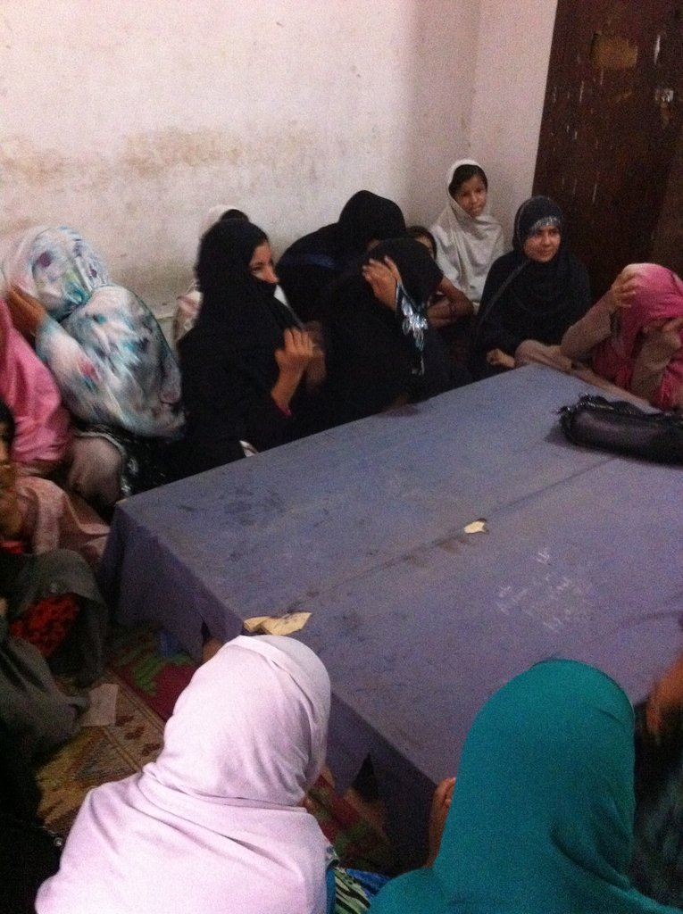 Students, like Zahra, in a tailoring class