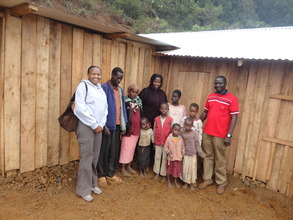 Childline Kenya staff with Mukami's family