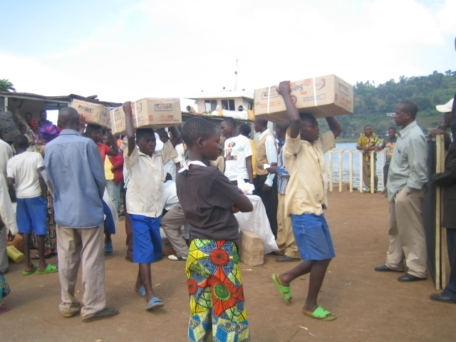 Students Unload Boxes of Supplies at Port