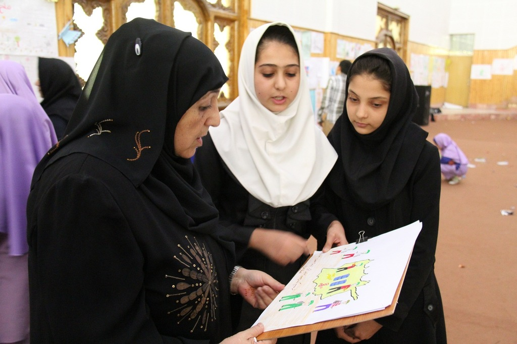 Dr. Sakena Yacoobi with young female students