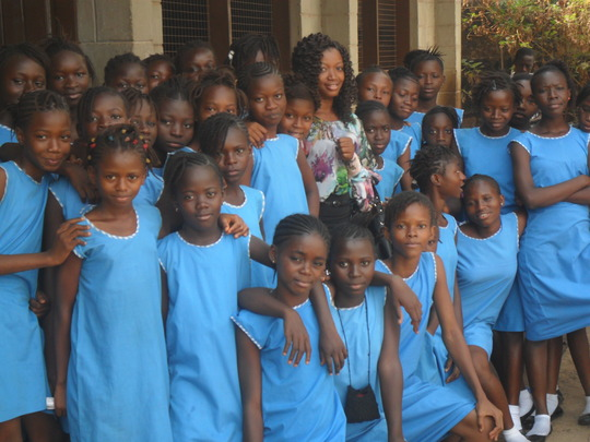 Juliana in group photo with girls at FAWE lab