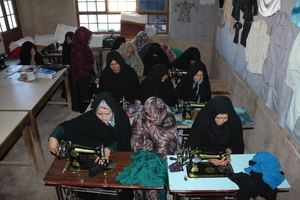 Women Using New Sewing Machines