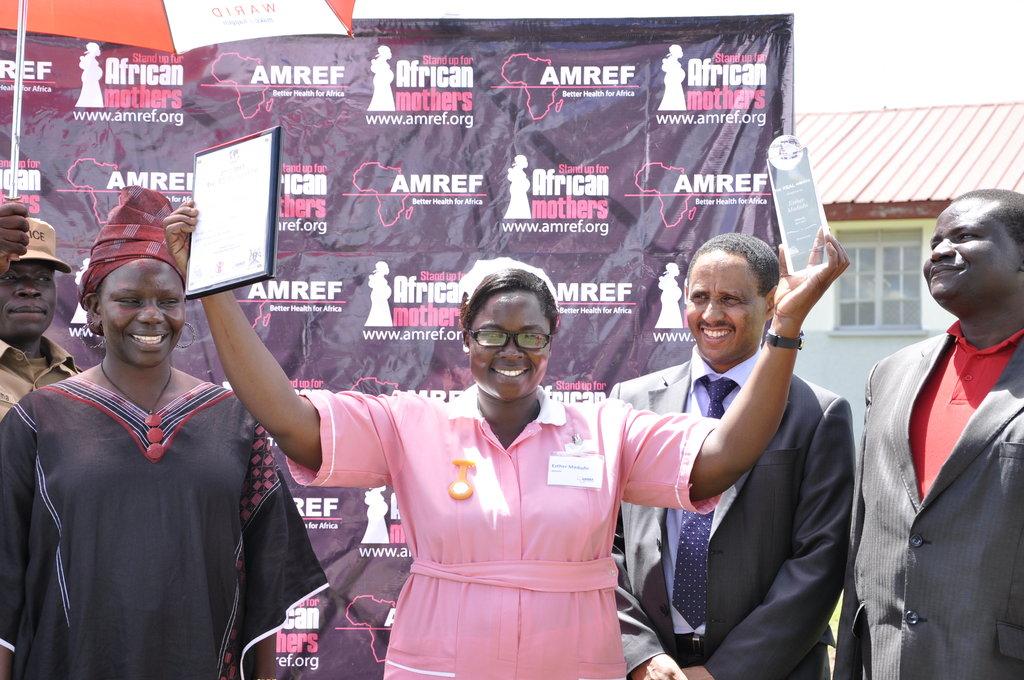 Esther Madudu with REAL Award