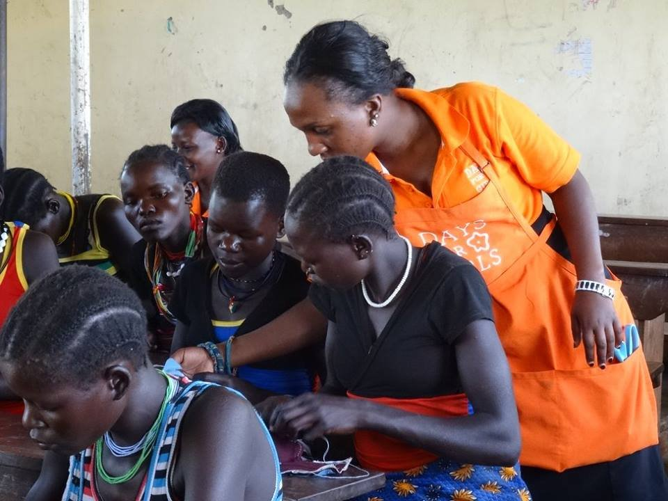 Samantha teaches girls to sew the DfG Kit