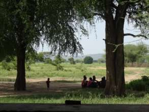 Focus Group discussion taking place under a tree