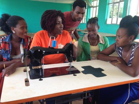 Training girls to use a treadle machine