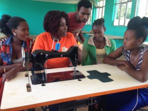 Training girls to use a treadle machine