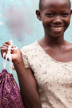 Receiving a kit of her own in Gulu, Uganda