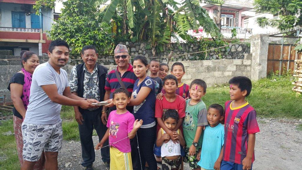 Community Liason, Lok, handing over the rent money