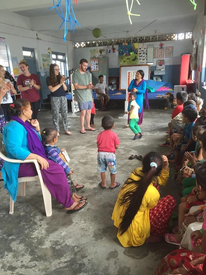 Happy children, staff and volunteers