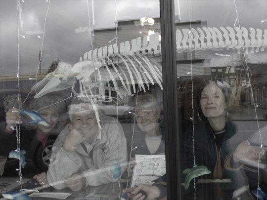 Happy volunteers and Maxine in Whale Center window