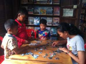 Children are playing game with a librarian