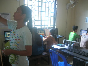 Youth team teaches computer students