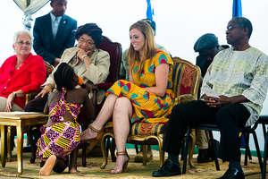 President Sirleaf listens at MTM Academy opening