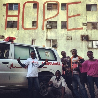 Some of our amazing team with the MTM ambulance.