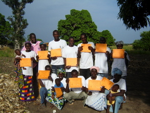 The graduates in Dialakoro Keleya show their certificates.