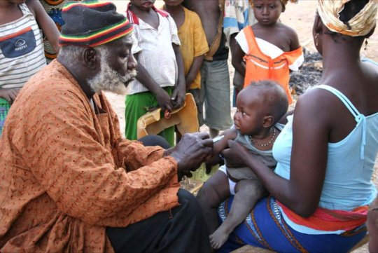 Health Agent Vaccinating a Child