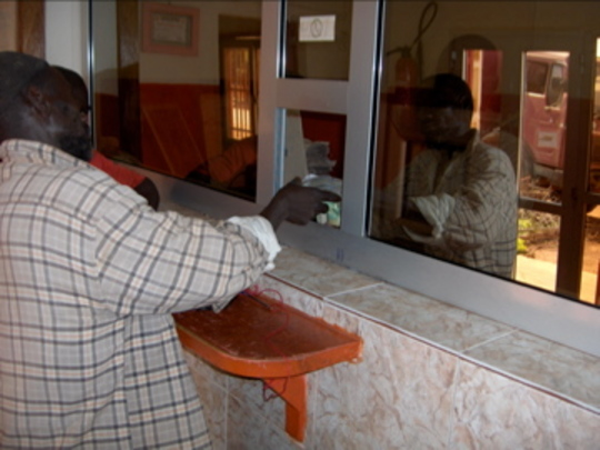 Villager repaying loan in Ouelessebougou