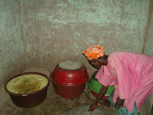 Village woman showing her processed shea butter.  It is now read