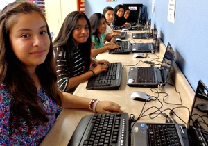 Giselle and classmates use the Club's tech lab
