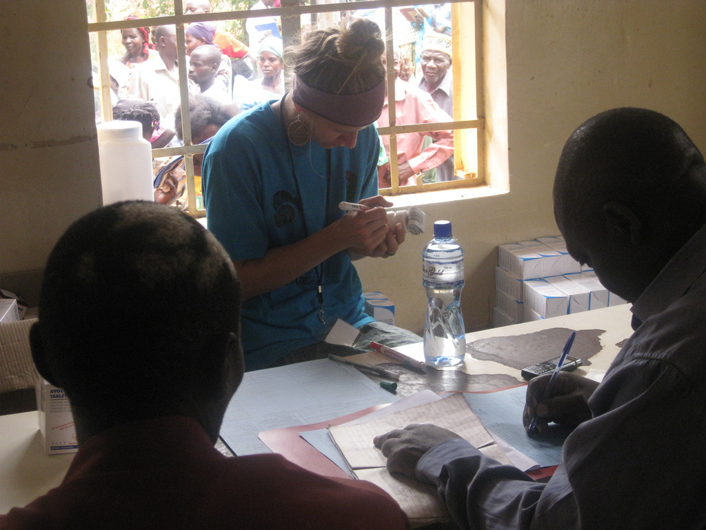 Volunteer documenting medication