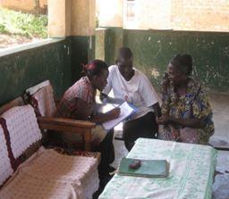 Volunteer Remy registering participants