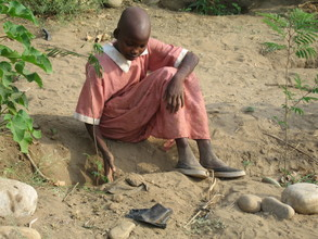 MASAI GIRL PLANTS A TREE