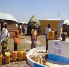 Community members line up for fresh water