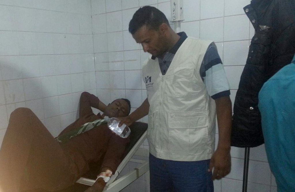 Mohammad treating a wounded patient