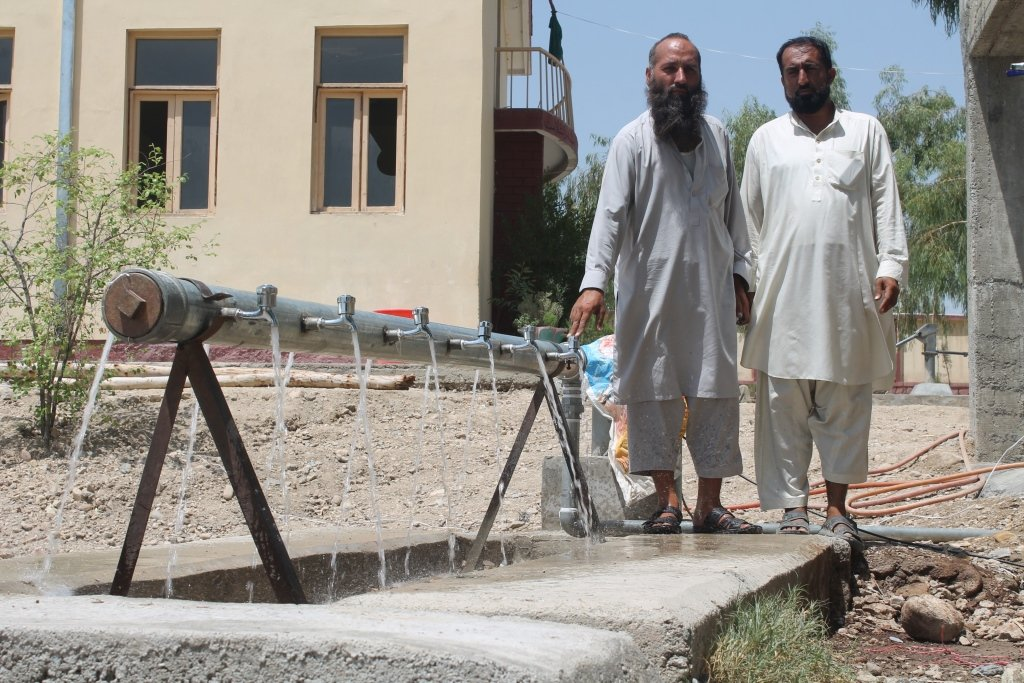 Officials pose with the new well