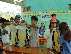 Villagers using the Waterbag