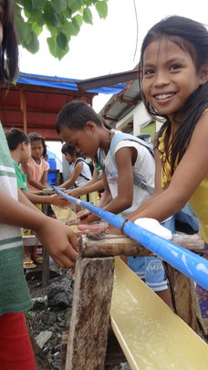 Children using a newly installed washing station