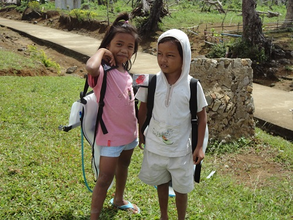 Children carrying Waterbags