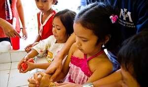 Children using the new hand washing station.