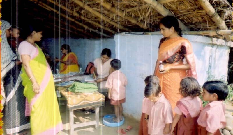 Children being weighed at a health camp