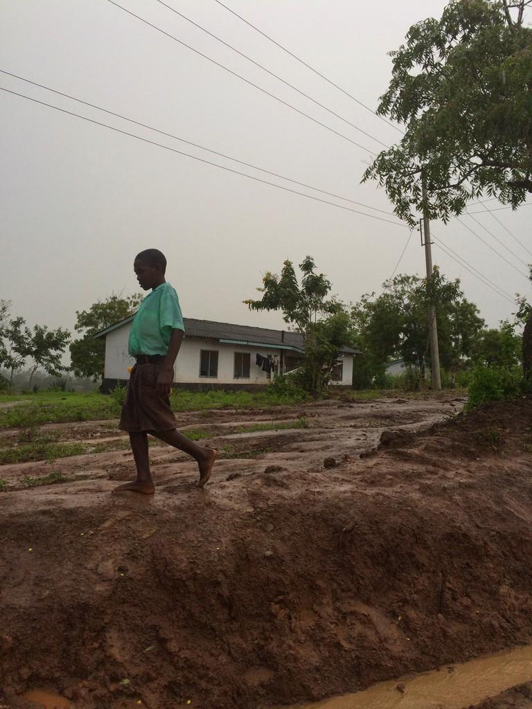 A student going back home from school in Samburu