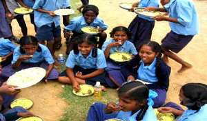 Children relishing their mid-day meal