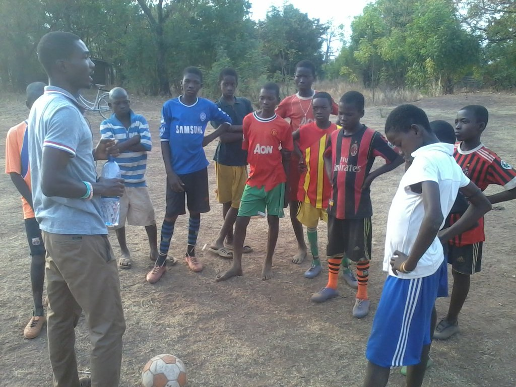 Boys mentor during training