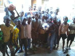 Youth of Yong Community with donated ball